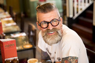 Quirky man in bar and restaurant, Bournemouth, England - CUF12367