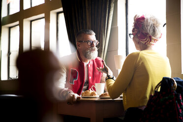 Quirky couple relaxing in bar and restaurant, Bournemouth, England - CUF12370