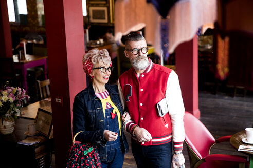 Quirky couple relaxing in bar and restaurant, Bournemouth, England - CUF12439