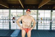 Senior man beside swimming pool - CUF12787