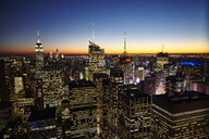 Elevated view of skyline at night with Empire State Building, New York City, USA - CUF13121