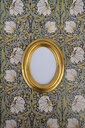 Oval golden picture frame on wallpaper with Art Nouveau floral design - AXF00806