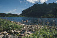 Norway, Lofoten, Moskenesoy, Three men bathing in Lake Agvatnet - GUSF00756