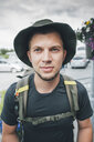 Portrait of backpacker with hat, travelling the Lofoten - GUSF00759