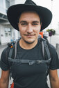 Portrait of backpacker with hat, travelling the Lofoten - GUSF00768