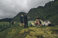Norway, Lofoten, Moskenesoy, Young men camping in the mountains - GUSF00774