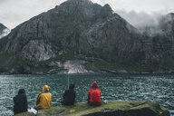 Norway, Lofoten, Moskenesoy, Young men fishing at Horseid Beach - GUSF00861
