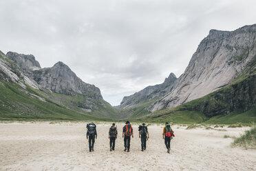 Norway, Lofoten, Moskenesoy, Young men hiking to Horseid Beach - GUSF00867