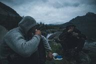 Norway, Lofoten, Moskensoy, Young men having breakfast at Selfjord - GUSF00873