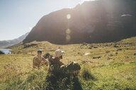 Norway, Lofoten, Moskenesoy, Young men resting at Litljordtinden - GUSF00879