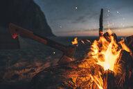 Norway, Lofoten, Moskenesoy, Camp fire at Kvalvika Beach - GUSF00897