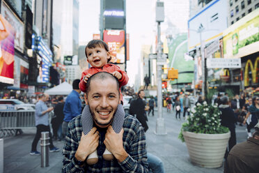 USA, New York, New York City, Times Square, Father with baby on shoulders - GEMF01998