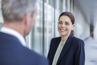 Portrait of smiling businesswoman face to face to business partner - DIGF04310