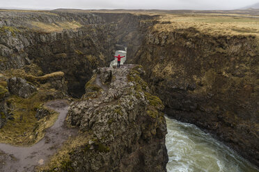 Iceland, North of Iceland, hiker looking to canyon - AFVF00528