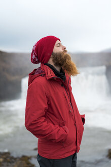 Iceland, North of Iceland, young man with closed eyes - AFVF00534