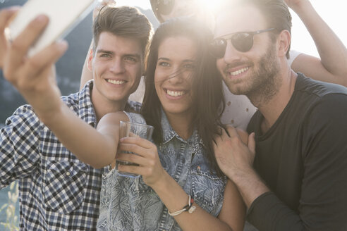 Young adult friends taking selfie at roof terrace party - ISF02210