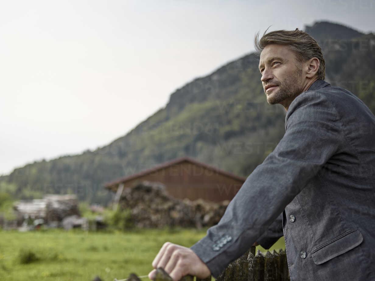 Businessman in rural landscape looking at view - CVF00583 - Christian Vorhofer/Westend61