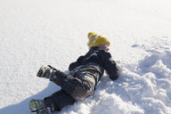 Young boy fooling around in snow - ISF02428