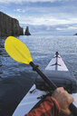 Point of view image of kayaker sea kayaking, Trinity Bay, Newfoundland, Canada - ISF02506