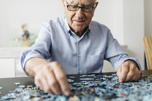 Senior man doing a jigsaw - JRFF01677