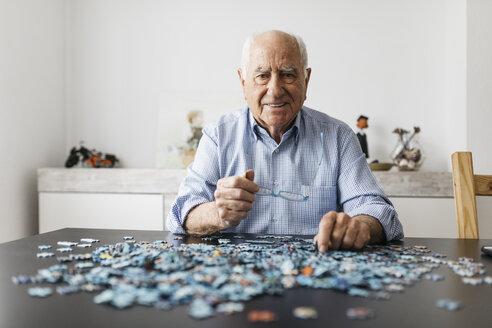 Senior man doing a jigsaw - JRFF01680