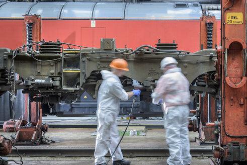 Locomotive engineers working on locomotive in train works - ISF02702