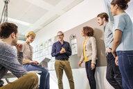 Digital design team talking in office meeting - ISF03393