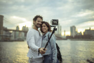 Couple taking photo with selfie stick, Brooklyn, New York, US - ISF03732