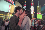 Couple kissing in Times Square, New York, United States, North America - ISF03738