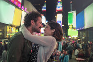 Couple hugging in Times Square, New York, United States, North America - ISF03741
