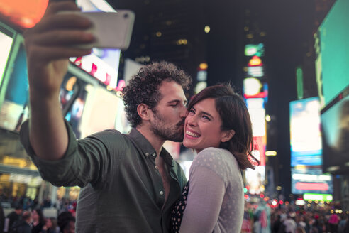 Couple taking selfie in Times Square, New York, United States, North America - ISF03744
