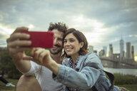 Couple taking selfie, Brooklyn, New York, US - ISF03831