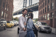 Couple taking photo with selfie stick, Brooklyn, New York, US - ISF03834