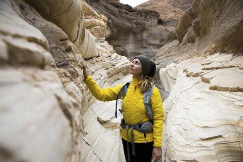 Trekker taking in sights, Death Valley National Park, California, US - ISF04446