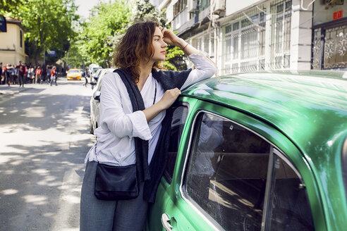 Woman beside green car - ISF04567