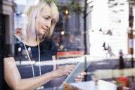 Businesswoman using digital tablet - ISF04919
