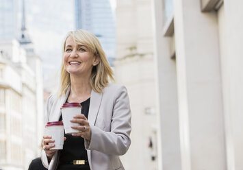 Businesswoman with coffee cups - ISF05012