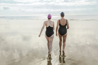Mother and daughter heading to sea, Folkestone, UK - ISF05108