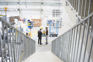 Supervisor and manager having discussion in distribution warehouse - ISF05447