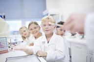Portrait of smiling pupils in science class - WESTF24079