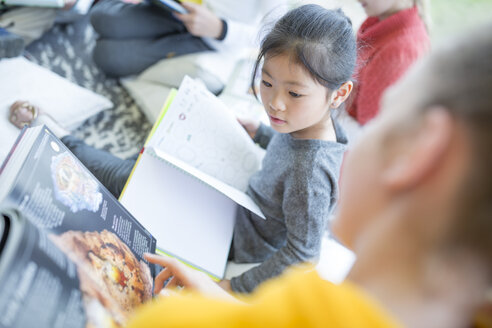 Pupils reading together in school - WESTF24085