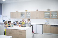 Pupils cooking together in cooking class - WESTF24091