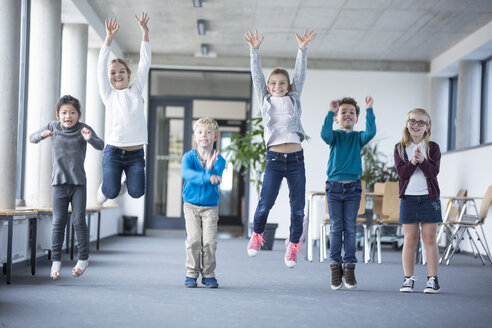 Excited pupils jumping on school corridor - WESTF24181