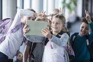 Happy pupils taking a selfie with tablet in school - WESTF24190