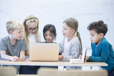 Pupils with laptop learning together in class - WESTF24217