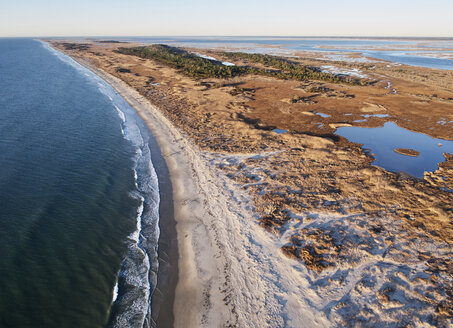 USA, Virginia, Aerial view of Virginia Coast Reserve, Atlantic Ocean, beach and marsh in the evening light - BCDF00353