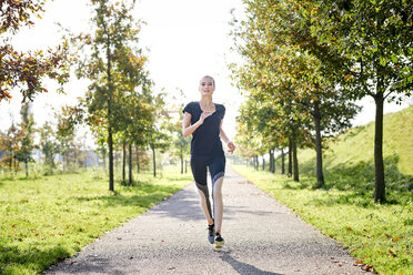 Young woman running in a park - MMIF00089