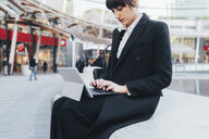 Businesswoman using digital tablet, Milan, Italy - ISF05965