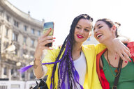 Women taking selfie, Milan, Italy - ISF05989