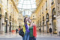 Women taking selfie in the Galleria Vittorio Emanuele II, Milan, Italy - ISF05995